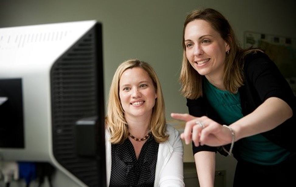 Two women in meeting in front of computer