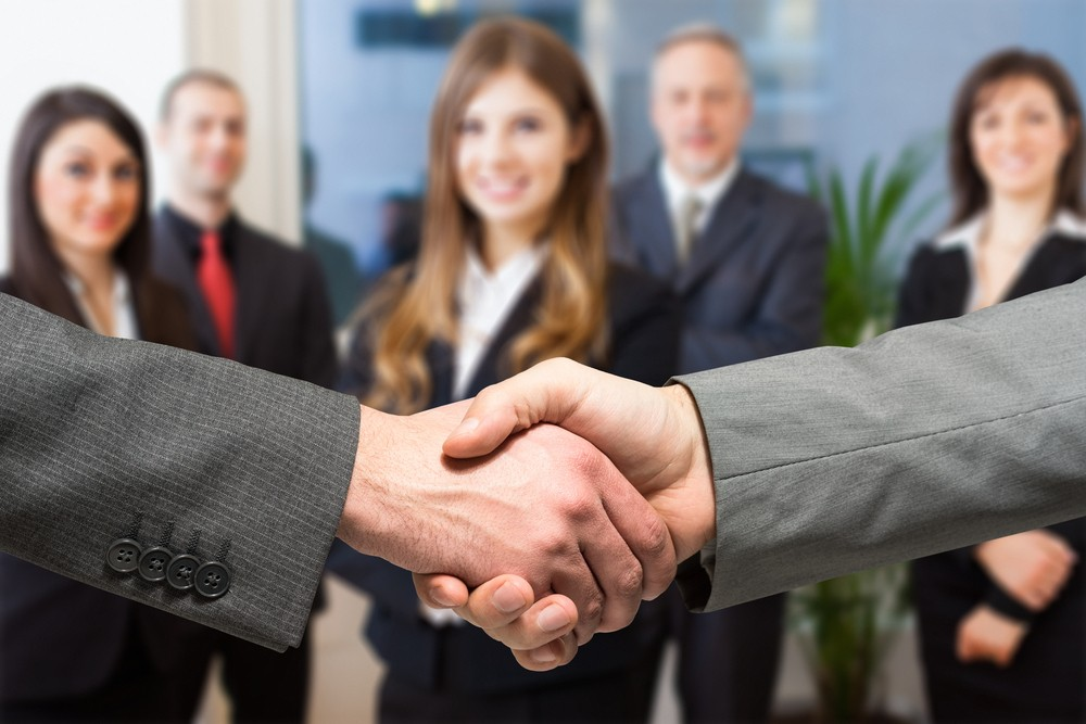 Photo of professionals shaking hands