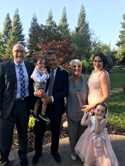 Image of FMP Employee, Maggie, and her family at her sister's wedding.
