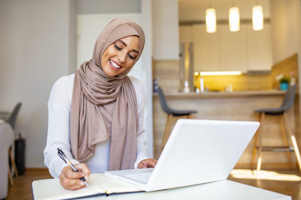 Hijabi woman working from home